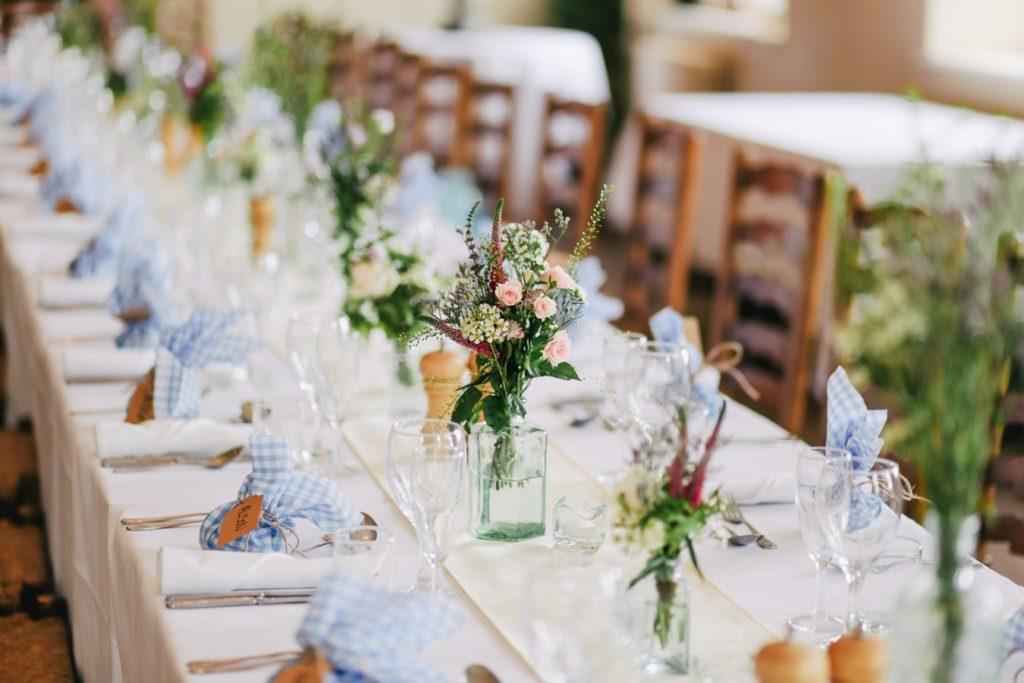 Wedding table set at community center