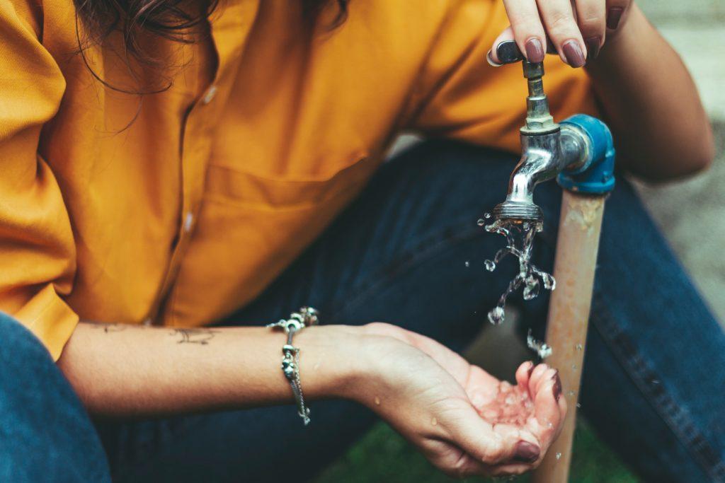 woman using faucet