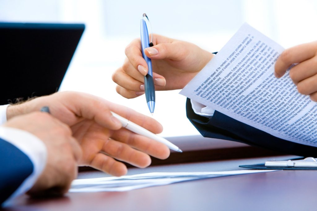 Two people discussing documents