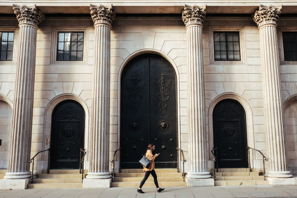 Woman walking in front of bank