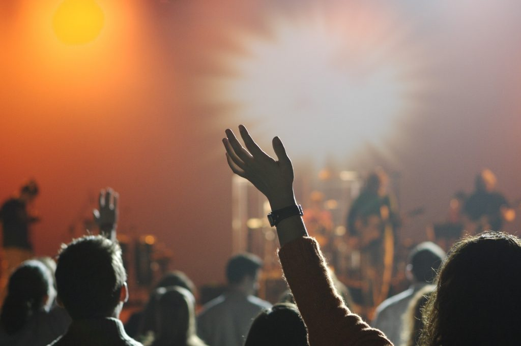 live music show with person putting hand in air