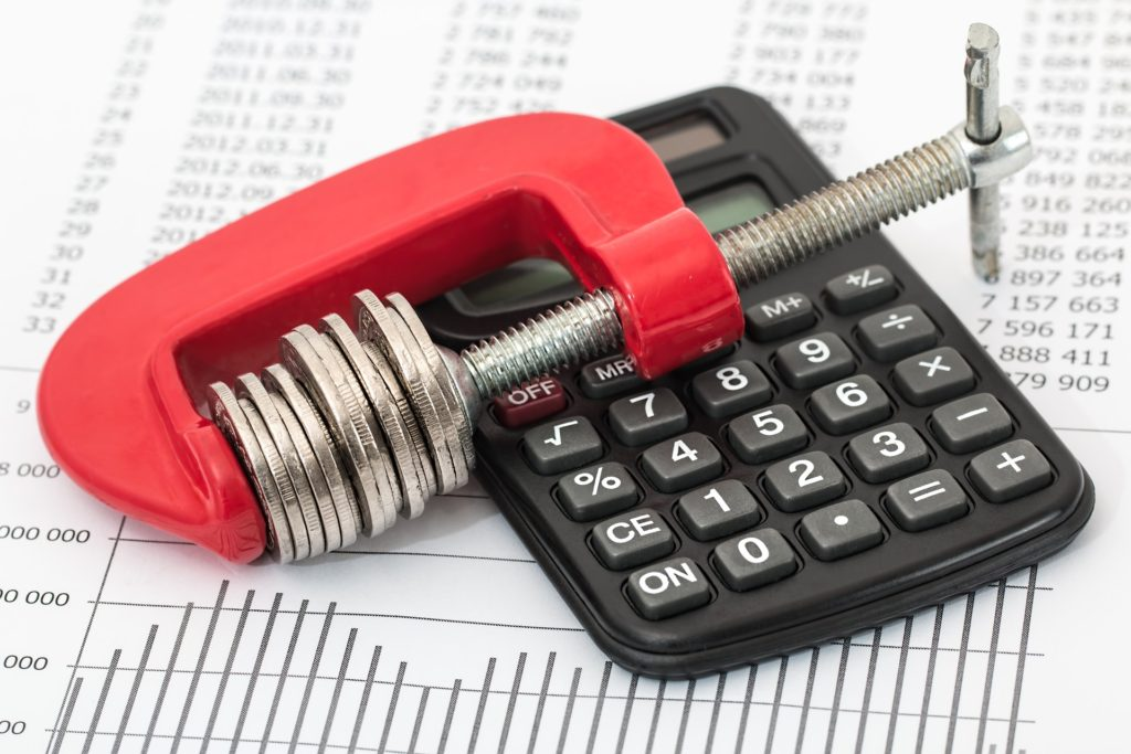 remodeling tool on calculator with budget in background