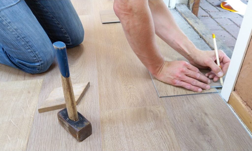 Person working on remodel on floor