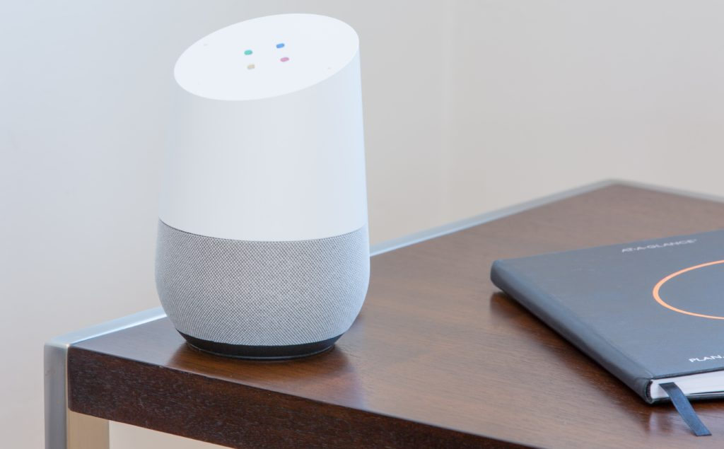 google home on wooden table