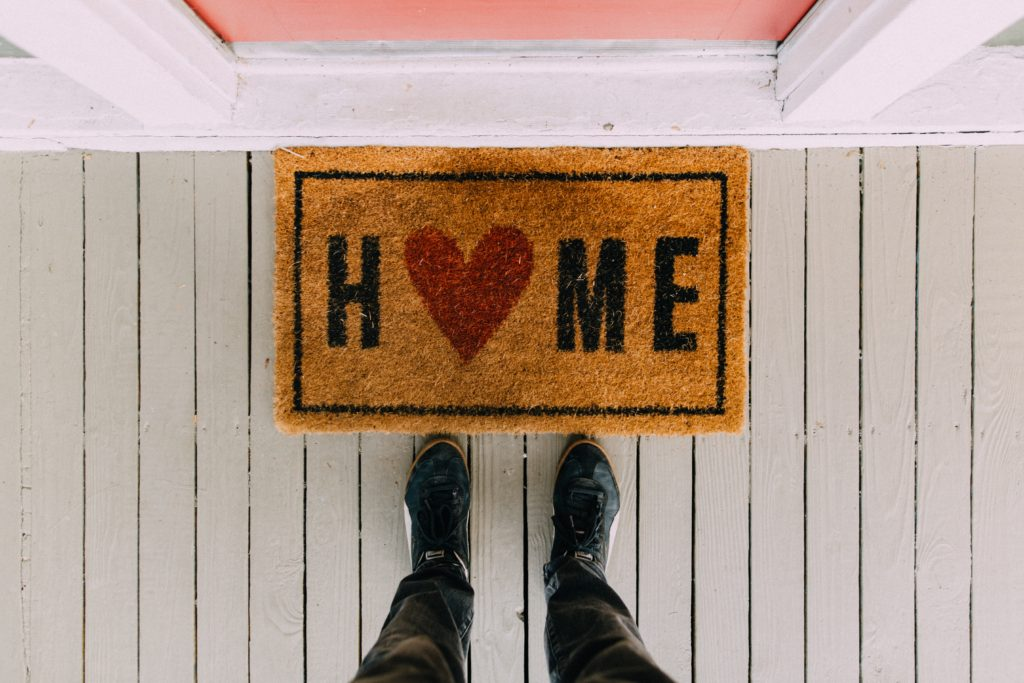 Welcome home mat with heart
