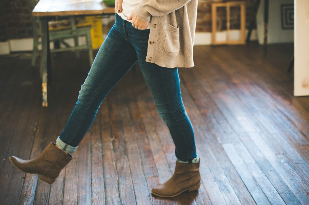 woman walking on hardwood floors