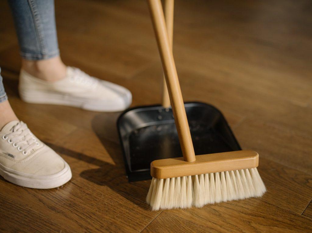 broom on hardwood floor