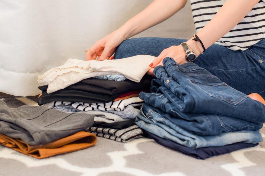 woman folding clothing