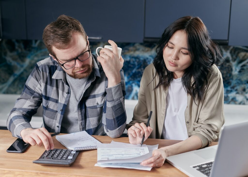 couple looking at credit score